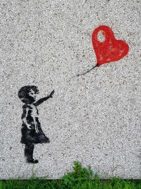 Ilustračný obrázok - graffiti zobrazúce dievčatko s odlietavajúcim balónom